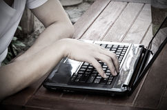 Image of mans hands typing. Stock Photos