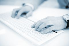 Image of man`s hands typing. Selective focus. Royalty Free Stock Image