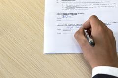 Signing Employment Contract on Desk with Copyspace royalty free stock images