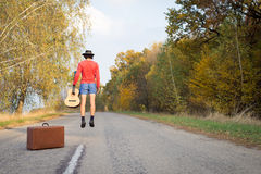 Image of man in shorts hitchhiking on sunny fall Stock Photo