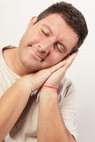 Image of a man sleeping and smiling Stock Images