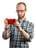 Image of man taking pictures with his smartphone isolated Royalty Free Stock Photography