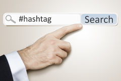 Web search hashtag. An image of a man who is searching the web hashtag Stock Image