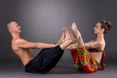 Image of man and woman doing yoga together Stock Photography