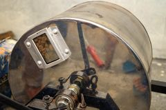 Manual rolling drum coffee roaster stock photos
