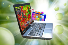 Image of many of berries on a laptop screen, stylized vitamins in the food trolley Stock Photos