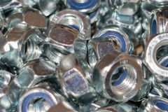 The image of many female screws. Shine metall background royalty free stock photos