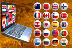 Image many flags and laptop closeup Royalty Free Stock Image