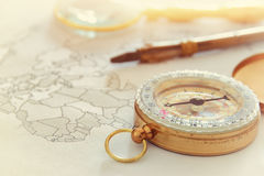Image of map, magnifying glass and old compass. selective focus