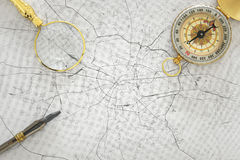 Image of map, magnifying glass and old compass. selective focus Stock Photo