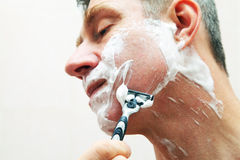 Image of mature man shaving Royalty Free Stock Photo