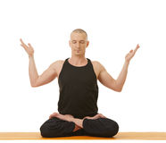 Image of meditator man posing in lotus position Stock Images
