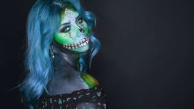 Image of mermaid, sugar skull in cold colors, lady with blue hair in dark room. Delightful image of dead mermaid, sugar sweet skull in cold colors, lady with stock footage