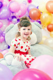 Image of merry little girl posing in playroom Stock Photos