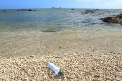 Message and bottle washed ashore Stock Photography