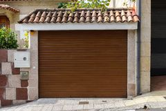 Metal garage door in a stone wall royalty free stock photo