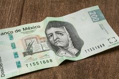 A 200 mexican pesos bill seems to be sad. The image of the mexican poet Sor Juana Ines de la Cruz, represented in a 200 mexican pesos bill, seems to be sad Royalty Free Stock Photography