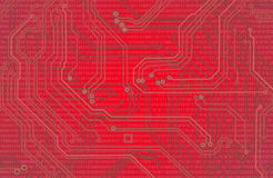 Image of microcircuit against a red background close up Royalty Free Stock Images