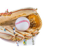 image of mini figure dolls with base ball glove and ball Royalty Free Stock Photos