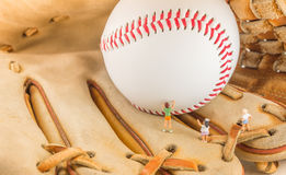 image of mini figure dolls with base ball glove and ball Stock Photo