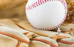 image of mini figure dolls with base ball glove and ball Royalty Free Stock Images