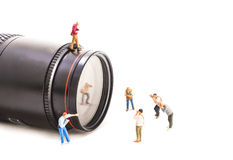 image of mini figure dolls photographer take picture on big DSLR Royalty Free Stock Photo