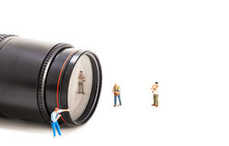 Image of mini figure dolls photographer take picture on big DSLR Stock Image