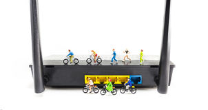 image of mini figure dolls riding bike and running on wifi route Stock Photos