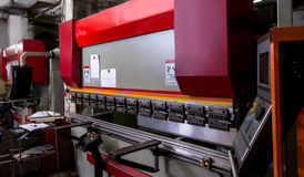 Image of modern bending machine in workshop Stock Photos