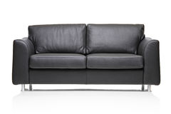 Image of a modern black leather sofa Royalty Free Stock Photography