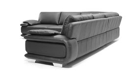 Image of a modern black leather sofa. Over white background Stock Images