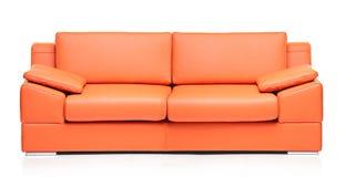 Image of a modern orange leather sofa Stock Image