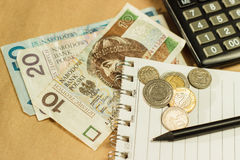 Image of money and a calculator Stock Image