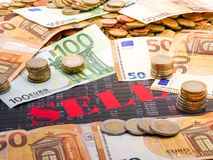 Image of money and the word sell on investment paper royalty free stock photo