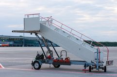 The image of a movable boarding ramp at the. Airport. Transportation background Stock Image