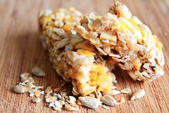 Muesli bar with nuts on the table. Image of muesli bar with and apple nuts on a table Stock Photos