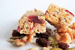 Muesli bar with nuts on the table. Image of muesli bar with and apple nuts on a table Stock Image