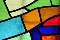 Image of a multicolored stained glass window with irregular bloc Royalty Free Stock Photo