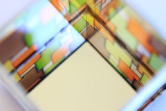 Image of a multicolored stained glass window. The image of a multicolored stained glass window with irregular block pattern in shades of green, orange and brown Stock Photography