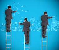 Image multiple d'homme d'affaires dessinant une ville photographie stock libre de droits