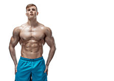 Image of muscle man posing in studio. Strong Athletic Man showing muscular body and sixpack abs isolated on white background Royalty Free Stock Photography