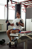 Image of muscular man exercising in gym Stock Photo