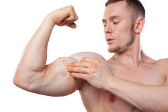 Image of muscular man measure his biceps with measuring tape in centimeters. Isolated on white backgound. Image of muscular man measure his biceps with measuring Royalty Free Stock Photos