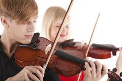 Image of musicians playing violins Royalty Free Stock Image