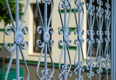 Image of a new decorative metal wrought fence with artistic forging. Iron guardrail close up Royalty Free Stock Photos