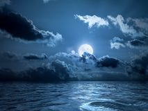 Full moon over the ocean stock photo