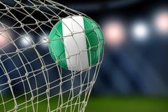 Nigerian soccerball in net. Image of Nigerian soccerball in net Royalty Free Stock Images