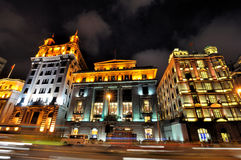Image of night in Shanghai Bund, China. Night view of China Shanghai Bund lighting buildings and street, shown as beautiful business city night landscape, and Royalty Free Stock Photography