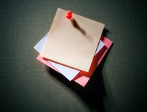 Image of note pad reminders on dark wall Stock Photography