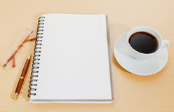 Image of notebook, coffee cup, pen and glasses Royalty Free Stock Image
